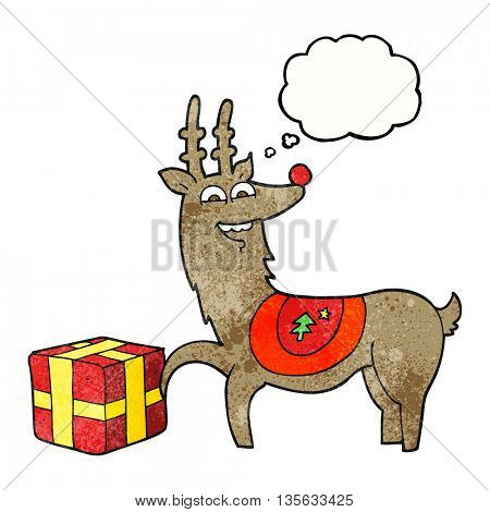 freehand drawn thought bubble textured cartoon christmas reindeer with present