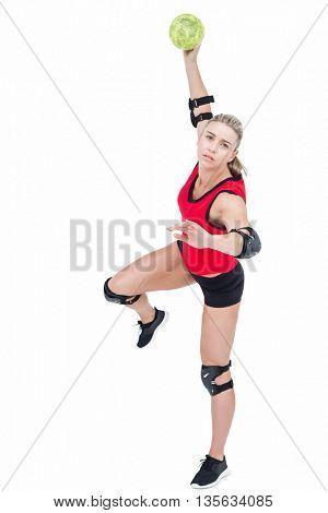 Female athlete throwing handball on white background