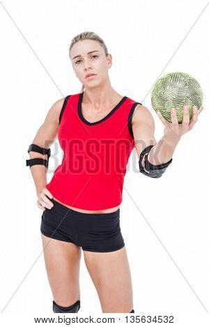 Female athlete with elbow pad holding handball on white background