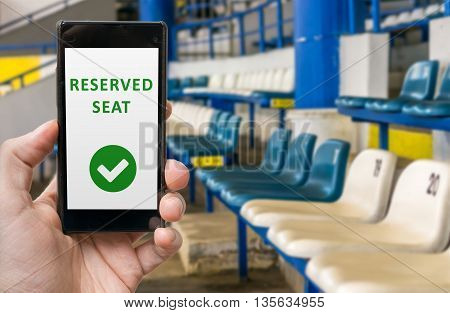 Man Has Reserved Seat In Stadium Online Via Smartphone.