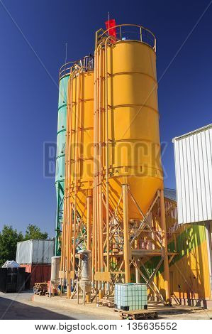 Three round metal towers on chemical plant