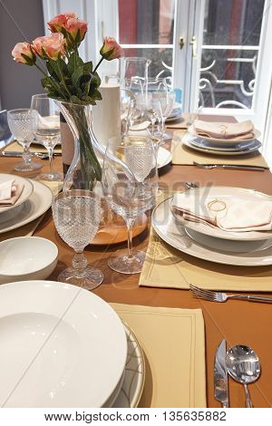 Table setting on a home dining room interior. Decoration