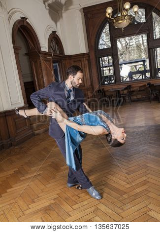 Dancer Bending Backwards While Supported By Man
