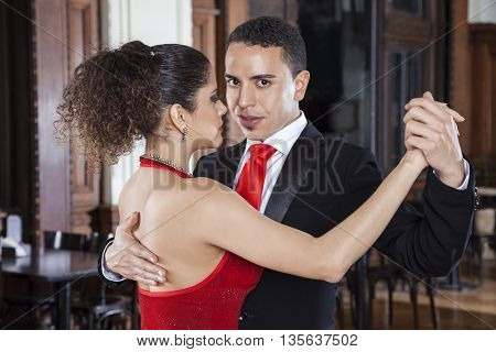 Male Tango Dancer Performing Gentle Embrace With Partner