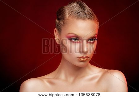 Girl With Red And Gold Make Up In Studio Photo