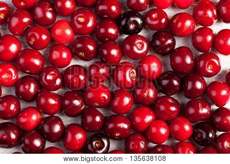 Raw Organic Cherries On Wooden Table