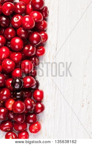 Delicious Cherries On White Wooden Background