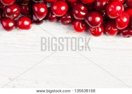 Fresh Looking Cherries On Wooden Background