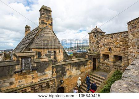 Edinburgh Scotland - July 28 2012: Visitors near the Argyle Tower of the Edinburgh castle