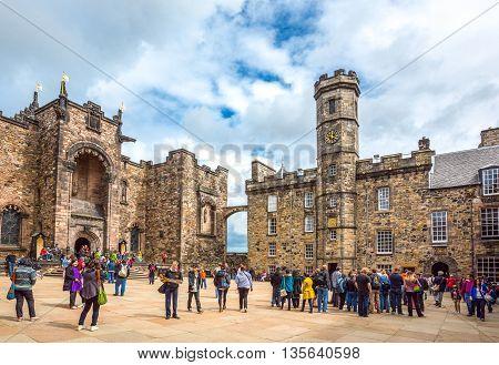 Edinburgh Scotland - July 28 2012: Tourists in the Royal Palace square of the Edinburgh castle