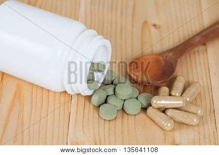 herb pill spilling out of a bottle