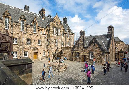 Edinburgh Scotland - July 28 2012: Visitors around the equestrian statue of the Field Marshal Earl Haig in the Edinburgh castle.