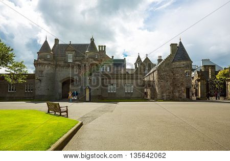 Edinburgh Scotland - July 28 2012: The entrance to forecourt of the Holyroodhouse Palace.