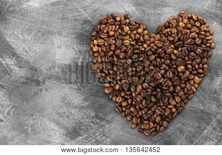 Coffee grains in form of heart on a dark background