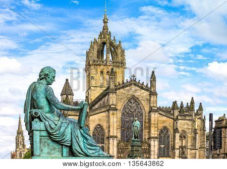 Great Britain Scotland Edinburgh The Royal Mile the St Giles Cathedral and in the foreground the monument to the philosopher David Hume.