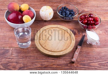Fruit and berries on a board on a table