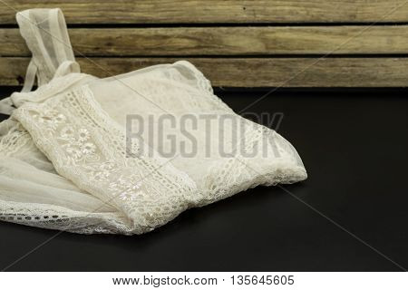 Beautiful Lingerie, Neatly Folded On Wooden Background