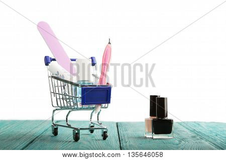 Shopping Cart With Cosmetics Isolated On White Background