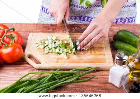 The Girl Cuts A Cucumber
