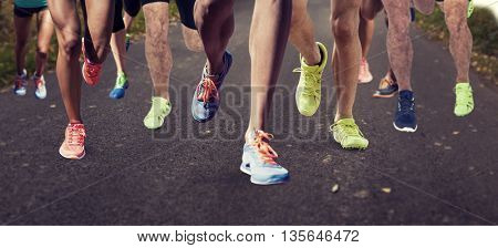 Close up of sportsman legs running on a against country road