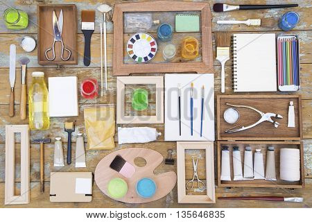 The various painting equipments on a wooden background