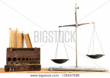 Old Libra And Stack Of Antique Books Isolated On White Background