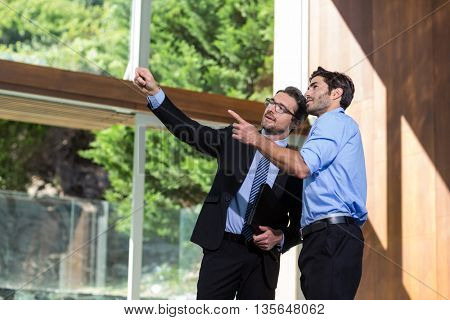 Real estate showing property to a man in resort