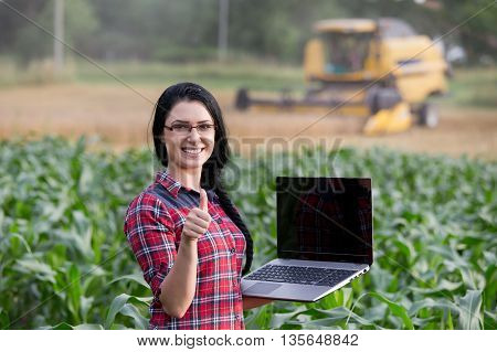 Famer Girl With Laptop In The Field
