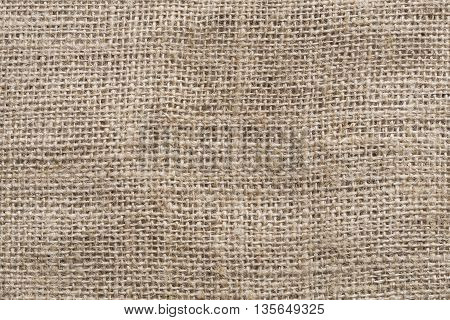The grunge rough burlap texture as background