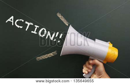 megaphone in front chalkboard with text action