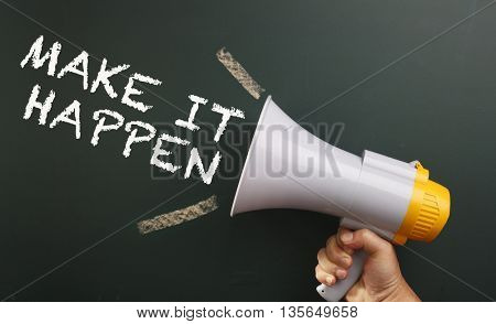megaphone in front chalkboard with text make it happen