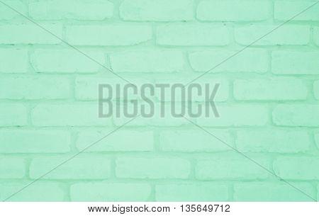 Closeup surface green brick wallpaper wall textured background