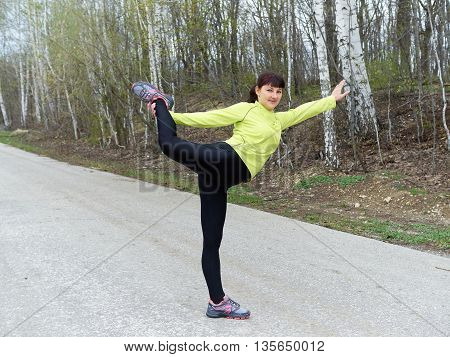 Young Woman Doing Natarajasana,