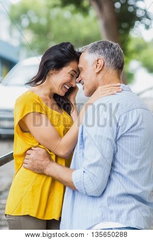 Side view of romantic couple standing outdoors
