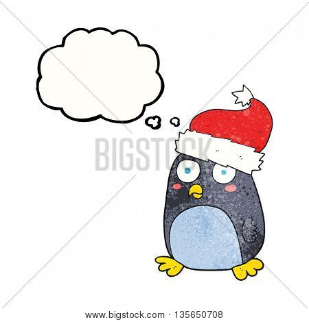 freehand drawn thought bubble textured cartoon penguin in christmas hat