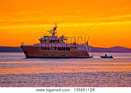 Yacht at golden sunset on open sea view luxury tourism