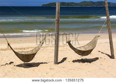 hammocks woven from a rod on the beach