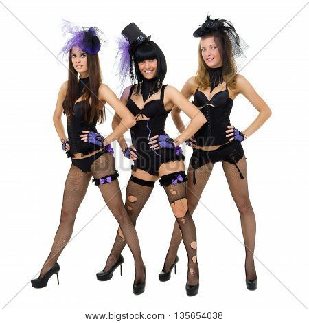 Three sexy play girls wearing a bunny costume posing against isolated white background in full length.
