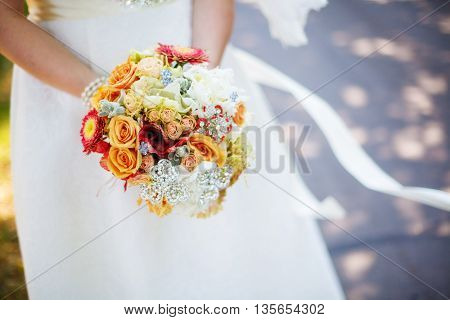 Bride In White Dress Holding Bouquet In Hands