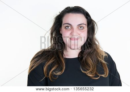 Smiling Woman Looking At The Camera Isolated On White
