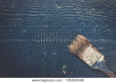 old brush on the blue wooden table