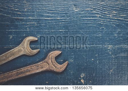 old rusty screw keys on the blue table