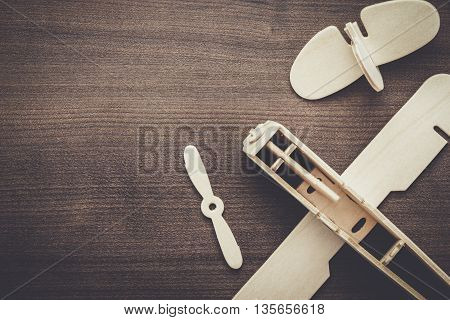 handmade airplane on the brown wooden table
