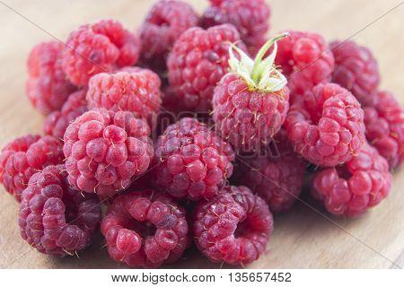 freshly picked ripe red raspberries. Raspberry fruit background