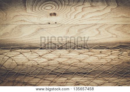 brown wooden background texture and fishing net