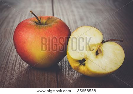 fresh red apples on the wooden table