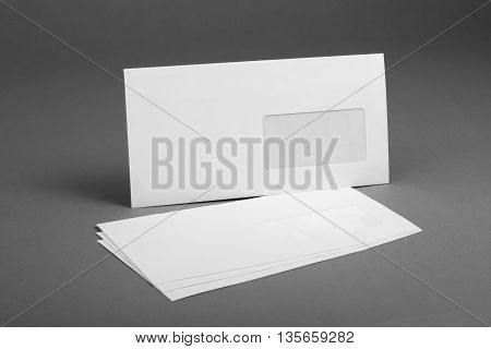 White envelope with address window on gray background