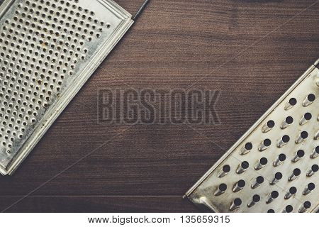 natural aged old rusted grater on the wooden table