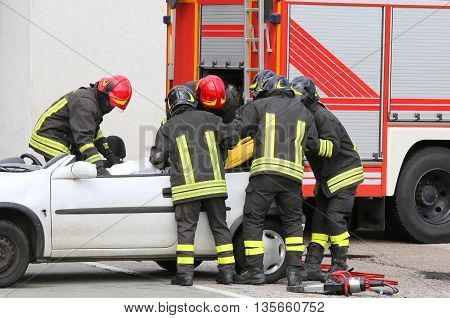 Firefighters Relieve An Injured After Car Accident