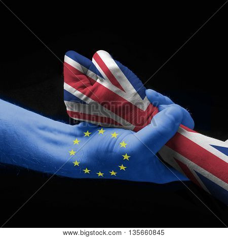 Two Hands that express the Brexit on black background